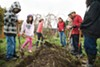 Students in the Edible Classroom turn the soil.
