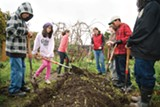 MELISSA BARNES - Students in the Edible Classroom turn the soil.
