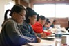 Students learn English at Lao Family Community Development Inc. in Oakland.