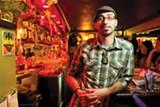 STEPHEN LOEWINSOHN - Tarik Kazaleh serves up reasonably priced drinks at The Layover.