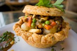 """CHRIS DUFFEY - The chicken pot pie was presented as a velvety chicken soup inside a cheddar crust """"bowl."""""""