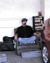 The filmmaker in his carport abode.
