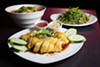 The Hainanese chicken is gently poached until tender, then taken off the bone and drizzled with soy sauce dressing.