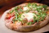 The pizza burbles with creamy mozzarella, nutty parmesan, and sharp <i>pecorino</i>.