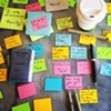 The Post-it Notes are color coded based on the theme of the message.