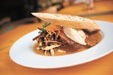 CHRIS DUFFEY - The slow-roasted pork shoulder is fork-tender, but needs spice.