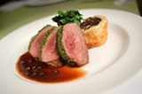 CHRIS DUFFEY - The tender and juicy lamb loin was wrapped up in a crust of chives, spinach, butter, and panko crumbs.