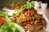 """CHRIS DUFFEY - The """"toothpick lamb"""" features miniature skewers of cumin-spiced meat."""