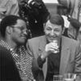 """The unholy trinity: Drew """"Bundini"""" Brown (Jamie Foxx), Howard Cosell (Jon Voight) and Don King  (Mykelti Williamson) wait for the Rumble in the Jungle in Ali."""