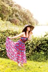 This summer, try a maxi dress paired with a wide-brimmed hat. Styled by Rare Bird.