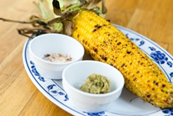 Hawker Fare's twist on grilled corn on the cob. - BERT JOHNSON