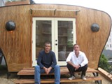 "LUKE TSAI - Tony Carr and Tom Biggs with their Sustainsia ""work pod."""