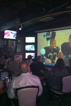 TV screens are abundant at Ricky's, and so are Raiders fans.