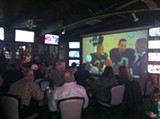ELLEN CUSHING - TV screens are abundant at Ricky's, and so are Raiders fans.