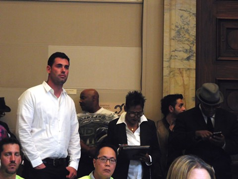 Danny Haber and Elaine Brown listen during the planning commission hearing.