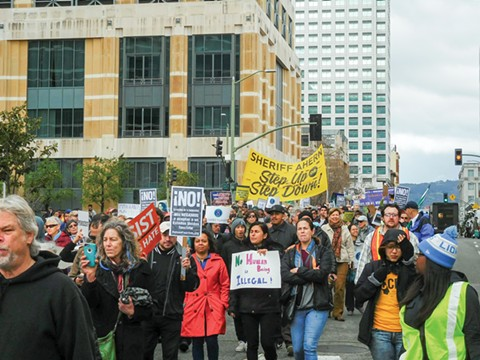 Supporters of the Alameda County United in Defense of Immigrants Rights coalition (which includes many of the organizations described in this story) marched in Oakland earlier this year to protest local law enforcement agencies that collaborate with ICE. - PHOTO BY DARWIN BONDGRAHAM