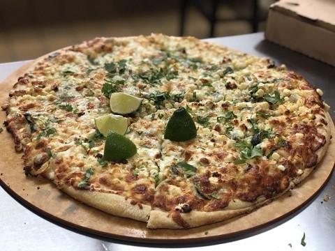 Pizza with corn, chile pasilla, onions, mozzarella, feta, and limes. - PHOTO COURTESY OF DIMOND SLICE PIZZA VIA YELP