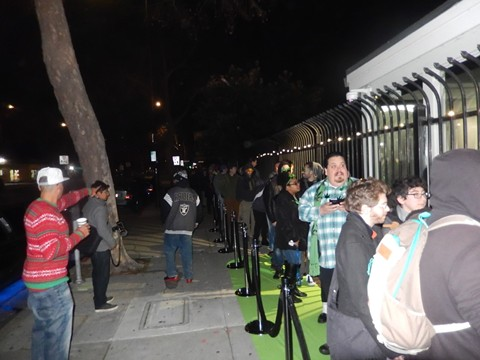Customers lined up at BPG in the predawn darkness on Jan. 1 - PHOTOS BY JOHN GELUARDI