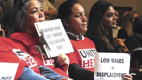 Unite HERE members protested the new hotel plan from Rahm Investments and its rep Tulsee Nathu (right). - PHOTO BY DARWIN BONDGRAHAM