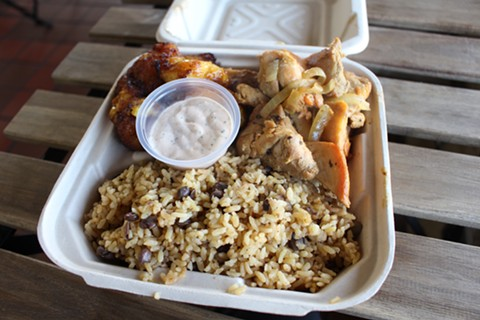 Garlic chicken, sweet plantains, and rice at La Perla. - JANELLE BITKER