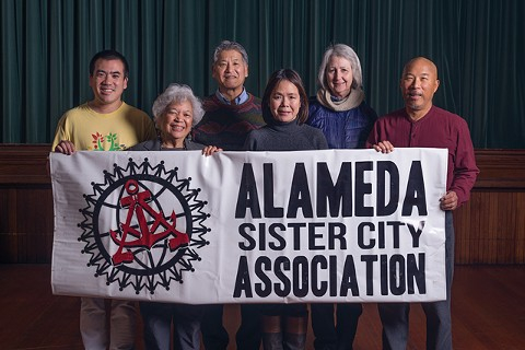 A group led by Pastor Michael Yoshii (rear center) asked the association to submit the sister-city proposal. - PHOTO BY LANCE YAMAMOTO