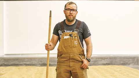 Admiral Maltings employee David Heitmann stands on the new facility's malting floor. - PHOTO BY SEAN BRADLEY