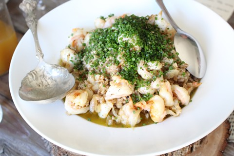 Shrimp and farro cooked in sparkling wine at a recent Monifa Dayo brunch. - JANELLE BITKER