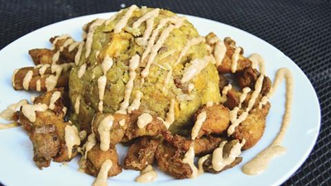 Mofongo with crispy, fatty chicken chicharrones. - PHOTO BY BRIAN BRENEMAN
