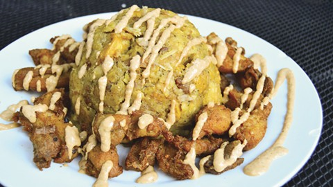 Mofongo with crispy, fatty chicken chicharrones. - PHOTO BY BRIAN BRENEMAN