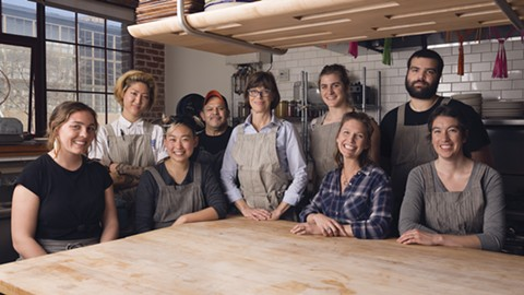 Kelsie Kerr (center) stands with her team in Standard Fare's large open kitchen. - PHOTO BY LANCE YAMAMOTO