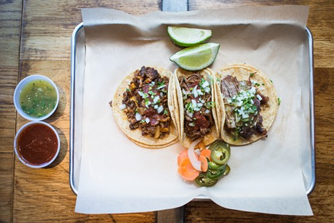 A trio of tacos from Comal Next Door. - PHOTO COURTESY OF CHARLIE VILLYARD