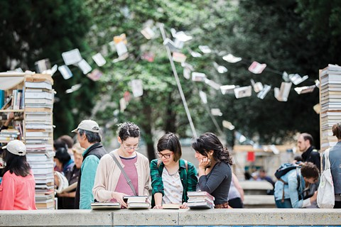Literary groups and indie bookstores line the streets of Berkeley for the Bay Area Book Festival. - PHOTO BY MICHAEL HITCHNER
