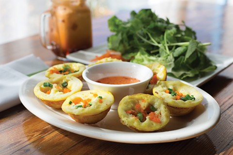 The Mekong turmeric cakes featured shrimp, coconut, and a borderline gooey texture. - PHOTO BY RICHARD LOMIBAO