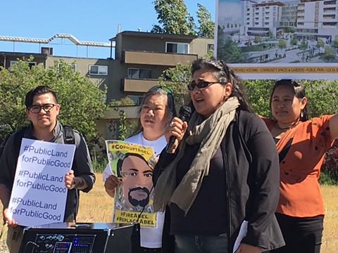 Dunya Alwan of the Eastlake United for Justice speaking at a press conference yesterday at the E. 12th Street remainder parcel site. - STEVEN TAVARES