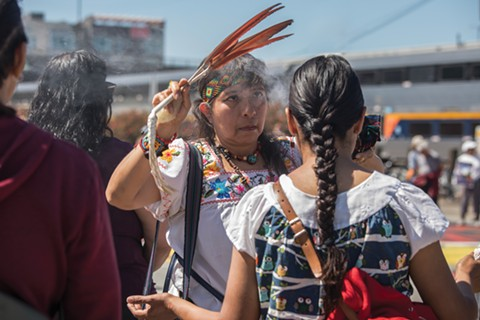 Chicueyi Coatl performs a Mexica cleansing ritual at the Save the Ohlone Shellmound Rally on May 28 in the Spenger's parking lot in Berkeley. - PHOTO BY LORI EANES