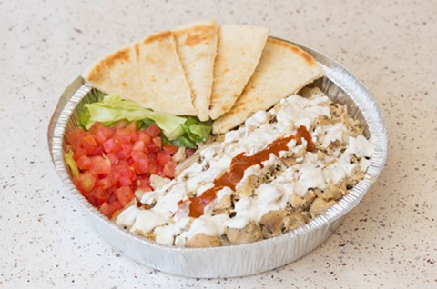 The chicken platter comes with tomatoes, lettuce, and pita. - PHOTO COURTESY OF HALAL GUYS