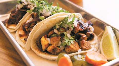 The achiote grilled chicken thighs (right) make for a tasty taco. - PHOTO BY LANCE YAMAMOTO