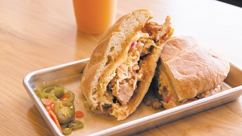 The fried chicken torta sings thanks to pickled jalapeños and chipotle mayo. - PHOTO BY LANCE YAMAMOTO