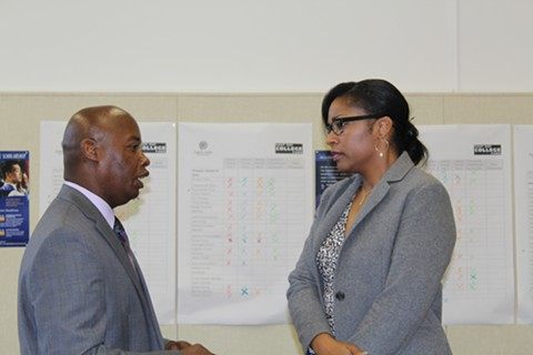 Marcus Battle, left, Oakland Unified's new chief business officer, speaks to Superintendent Kyla Johnson-Trammell. - THERESA HARRINGTON FOR EDSOURCE