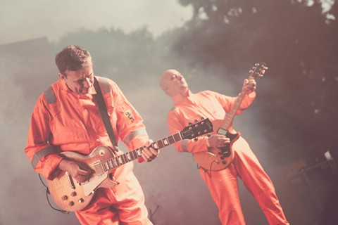 Devo headlined the first day of the festival. - ERIKA REINSEL
