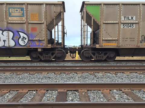 Coal dust can blow off the tops of rail cars. - PHOTO BY DARWIN BONDGRAHAM