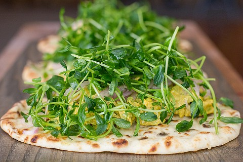 Naan topped with curry chicken salad and arugula. - PHOTO COURTESY OF ISABEL BAER