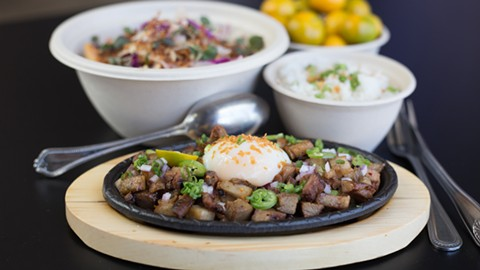 The pork belly sisig is finished with a perfect sous vide egg. - PHOTO BY RICHARD LOMIBAO