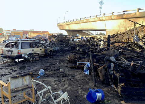 The fire destroyed numerous tents, cabins, and at least one vehicle.