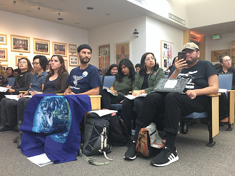 Immigrant rights organizers at today's hearing.