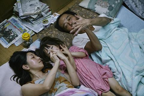 caption: Sakura Ando, Miyu Sasaki, and Lily Franky star in Shoplifters.