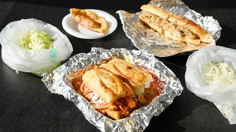 The lonche de pierna (center) is a torta stuffed with pork leg meat in adobo sauce. - PHOTO BY LANCE YAMAMOTO