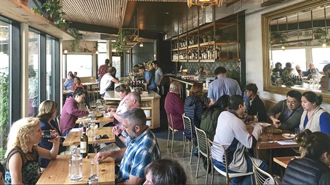 Diners chow down at Top Hatters Kitchen. - PHOTO BY EMILY NATHON