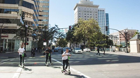 It didn't take long after the introduction of scooters to downtown Oakland for the complexion of transportation to begin changing. - PHOTO BY PAUL HAGGARD