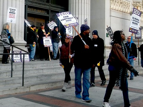 Members of SEIU Local 1021 protesting in front of Oakland City Hall in 2018. - DARWIN BONDGRAHAM